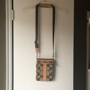 Coach signature print sling with tan leather